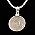 DOMINICAN REPUBLIC 1951 FIVE CENTAVOS DIAMOND CUT BEZEL SEVEN EIGHTS IN 45 REV