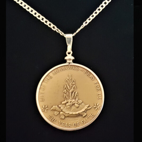 Saint Kateri Medal by Garrison Garrow A Mohawk Artist1.50 in 38.00 x 4.40 mm Coin Edge Sterling Silver Plated Bezel Sterling Silver Chain rev 8+18+5+18=69 REV