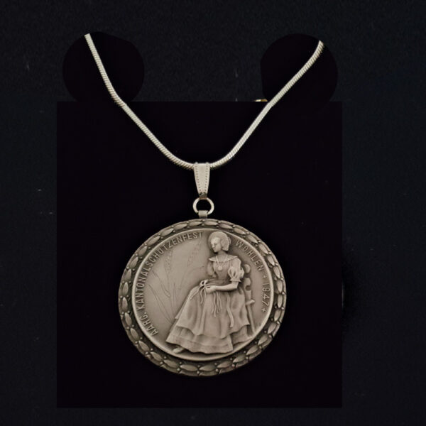 Swiss Peuter Seated Woman 1947 .979 oz 18 in x1.50 mm Sterling Silver Snake Chain 1.50 in x39.50 x 3.60 mm 10.57 OB MOD